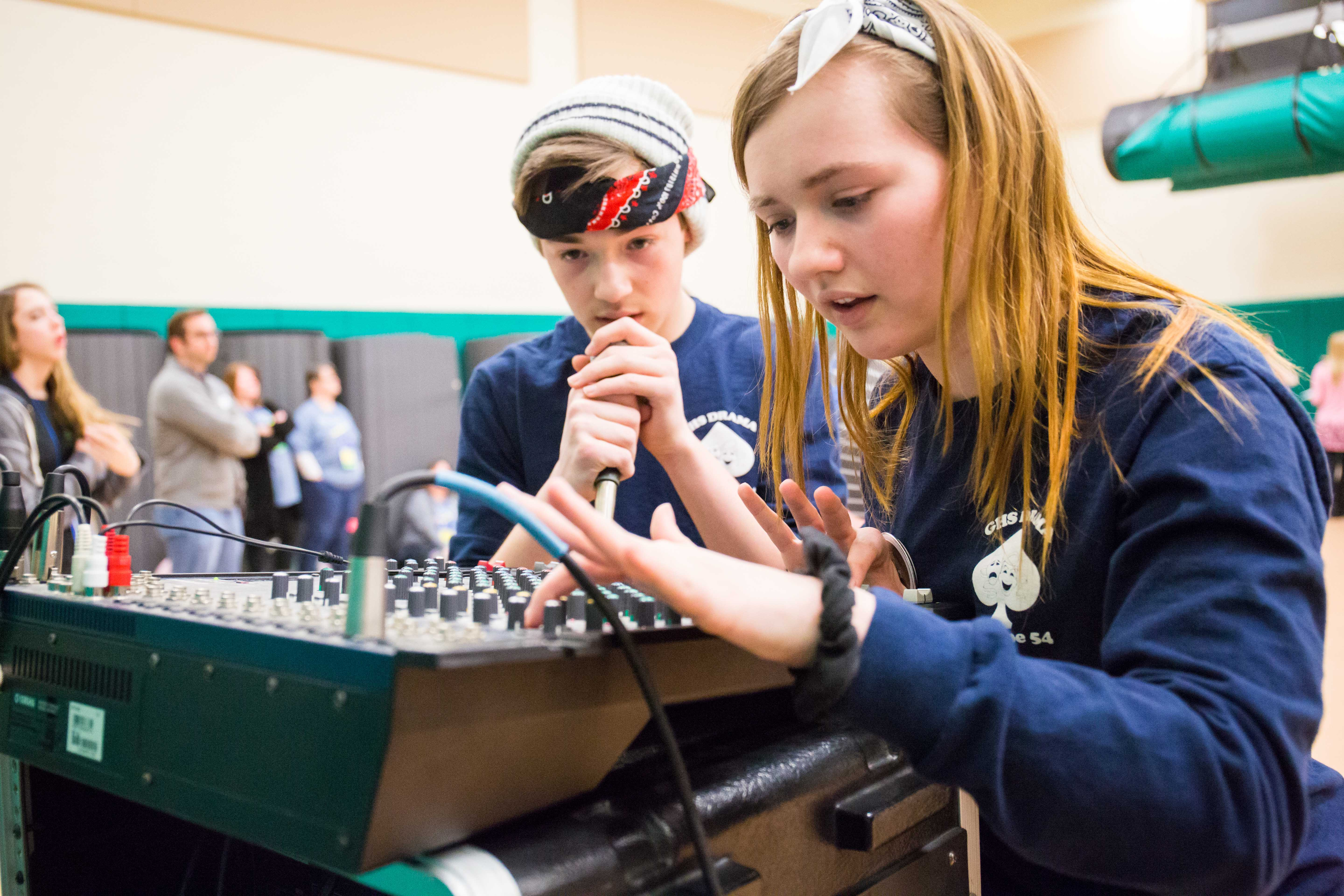 Two students working at a lighting board